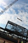 Photo of crane hoisting beam at Dulles South Multipurpose Center