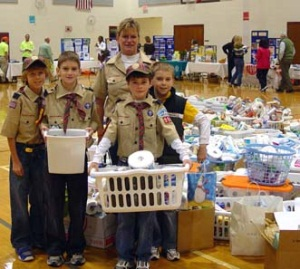 Local Scout troops displaying donations to Holiday Coalition