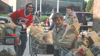 Boy Scouts push carts of donations